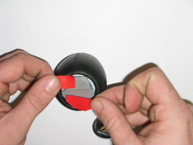 Use the included double sided adhesive tape or another adhesive of your choice.